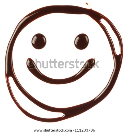 Smiley face made of chocolate syrup is isolated on a white background