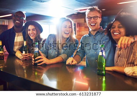 Smiley friendly people in the bar with a beer looking at camera. Friends and fun concept. #613231877