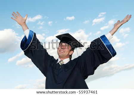 smiley graduate student in cloak with open risen arms ourdoors