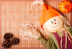 Smiley halloween scarecrow on a wooden background top view shot