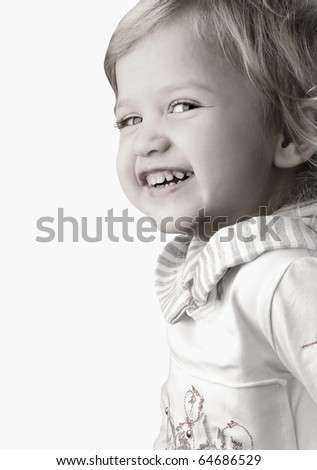 Smiley happy little girl close-up on white background