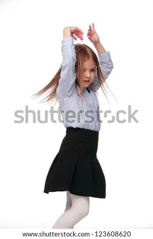 Smiley schoolgirl on white background on Beauty and Fashion theme/Young pretty girl wearing school uniform on Education theme