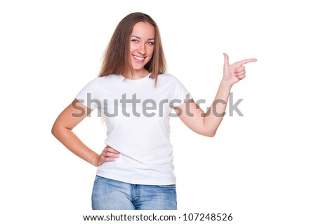 smiley young female pointing at empty copyspace. isolated on white background