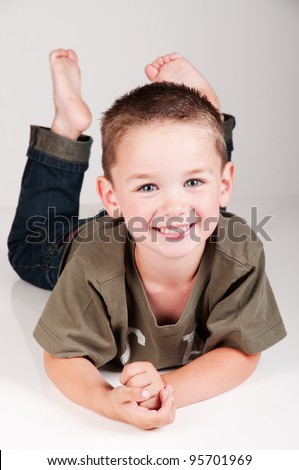 smiling adorable boy with bare feet - stock photo