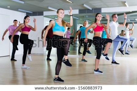 Smiling adults of different ages dancing at dance class Photo stock ©