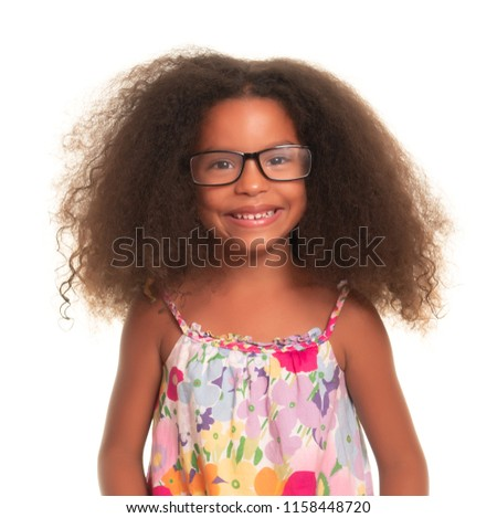 Smiling African American girl wearing glasses on an isolated white background