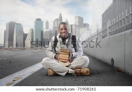 Smiling african student on a city street