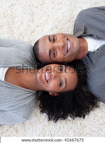 stock photo : Smiling Afro-American couple lying on the floor at home