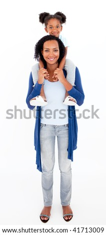Smiling Afro-american mother giving her daughter piggiback ride