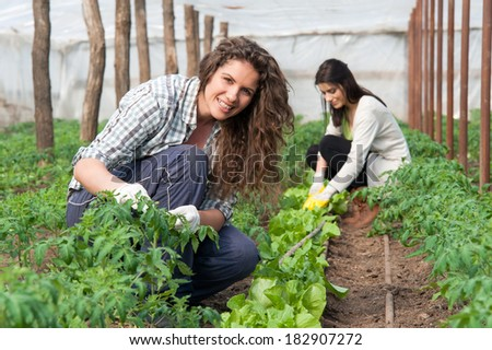 Smiling agriculture woman worker in front and colleague in back