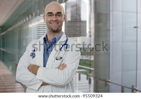 Smiling and confident Doctor standing with arms crossed
