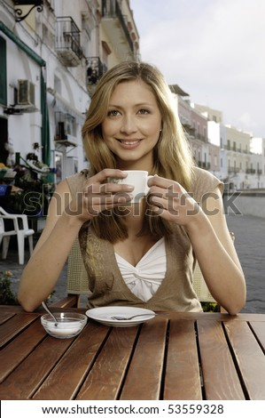 smiling and drinking cappuccino