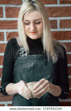 Smiling and happy woman making ceramic bowl in hand. Creative hobby concept. Earn extra money, side hustle, turning hobbies into cash, passion into a job, vertical #1569962164