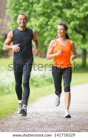Smiling and running sport team