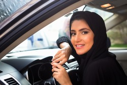Smiling Arab Women inside a car