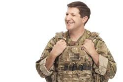 Smiling army soldier looking away