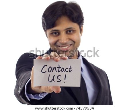 Smiling Asian business man holding a card- Contact Us! isolated over white background