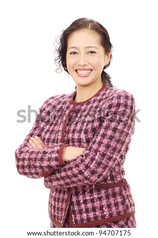 Smiling asian business woman with arms crossed