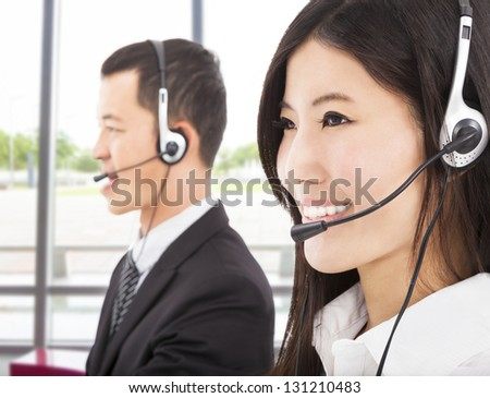smiling asian businessman with call center agent