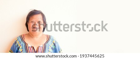 smiling asian down syndrome woman.Adult down syndrome.mentally disabled woman.Therapy mental health.Happy woman mother.Disability person.caregiver, Senior woman portrait.health, care, medical work.
