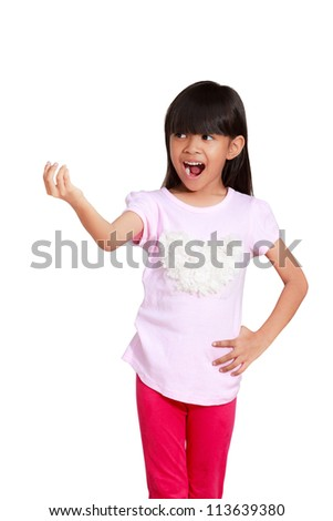 Smiling asian little girl showing empty copyspace on open hand, Isolated on white