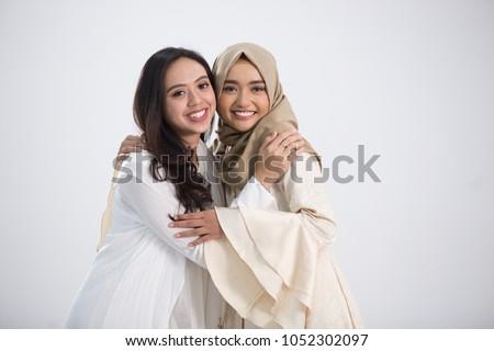 Smiling asian muslim bestfriend in front of camera. eid mubarak concept