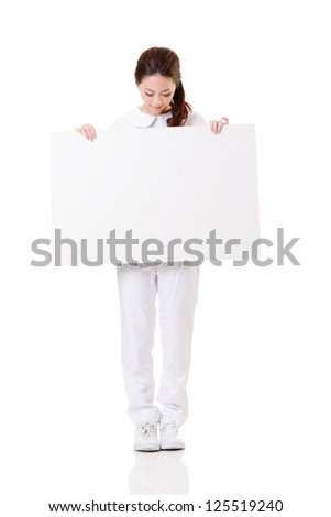 Smiling Asian nurse holding blank board, woman portrait isolated on white background.