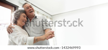 Smiling Asian Senior couple Celebrating Wedding Anniversary with dancing at the house. Chinese Lover. Happy, Romantic, lover. Banner, Panoramic, Copy space.