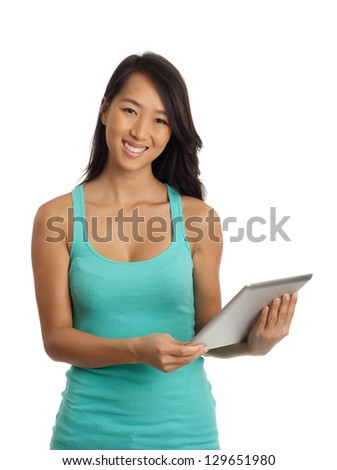 smiling Asian woman holding a digital tablet