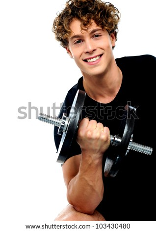 Smiling athlete doing exercise with dumbbell - stock photo