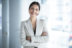 Smiling Attractive Business Lady in Office Hall