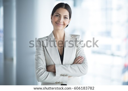 Smiling Attractive Business Lady in Office Hall #606183782