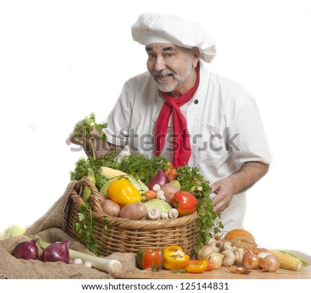 smiling attractive chef with vegetables
