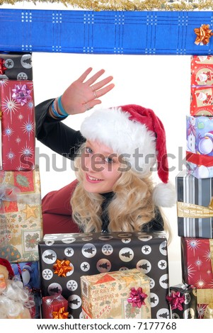 Smiling attractive teenager girl teen surrounded with Christmas xmas gifts.  White background.