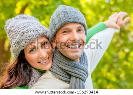 smiling autumn spring couple with outstretched arms