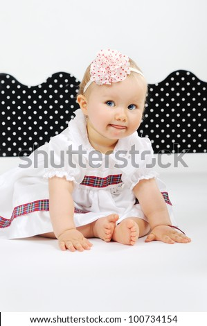Smiling Baby dressed in white dress