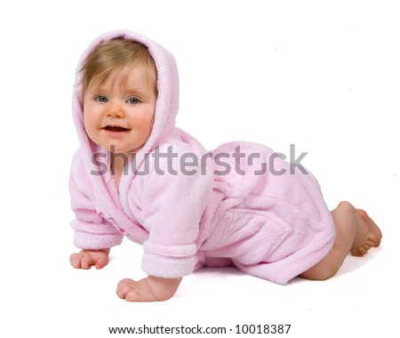 Smiling baby girl in pink bathrobe crawling isolated on white