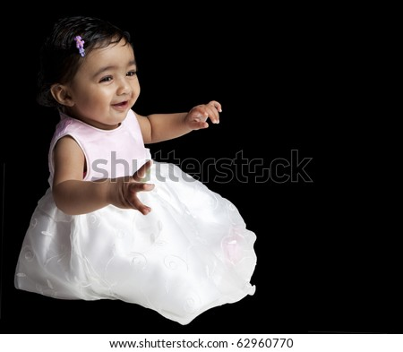 Smiling Baby Girl Isolated on Black