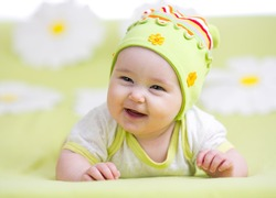 smiling baby girl over flower background