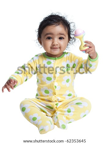 Smiling Baby Girl Playing with a Rattle, Isolated, White