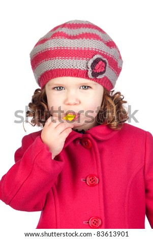 Smiling baby girl with wool cap isolated over white background