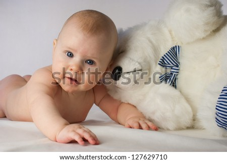 Smiling baby on white background with toy