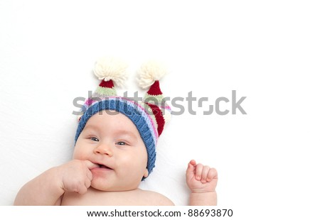 smiling baby with a funny hat - stock photo