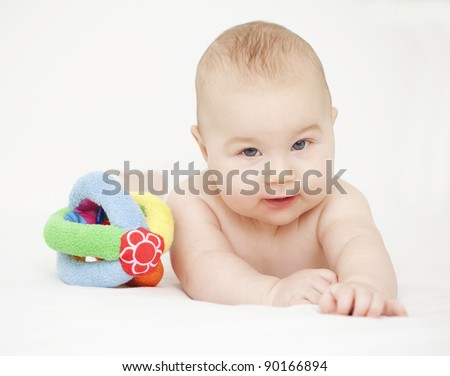 smiling baby with a toy