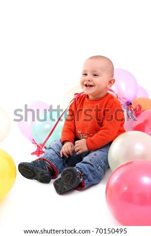 Smiling baby with balloons