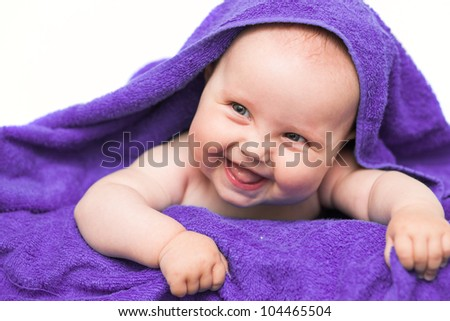 Smiling baby with towel