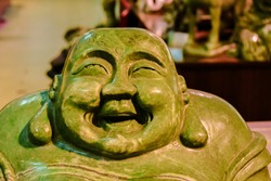 Smiling Badha green jade statue