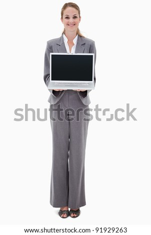 Smiling bank employee presenting her laptop against a white background