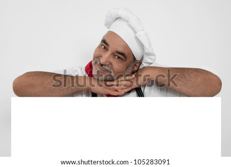 smiling bearded chef with white page