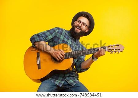 smiling bearded musician man...